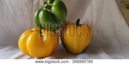 Yellow capsicum chillies with white background. Yellow pepper white background. Pepper vegetable on