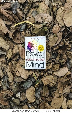 New Delhi, Delhi / India - May 31 2020: Power Of Subconscious Mind Book Lying On The Heap Of Died Le