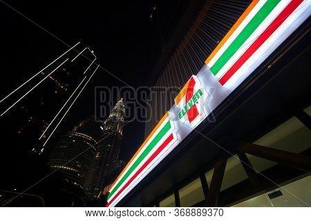 KUALA LUMPUR, MALAYSIA - CIRCA JANUARY, 2020: 7-Eleven sign seen in Kuala Lumpur at night.