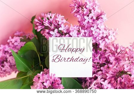 Happy Birthday Lettering And Beautiful Spring Bouquet Of Lilac Flowers, Holiday Gift Concept