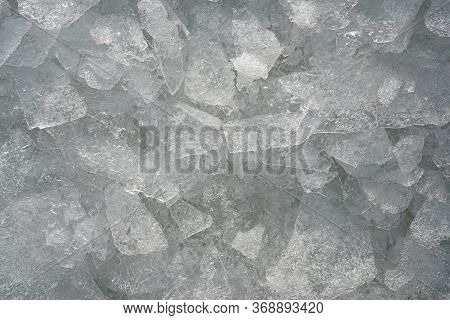 Background Image Of Black And White Stones. The Texture Of Wet Filler For The Pool. The Bottom Is St