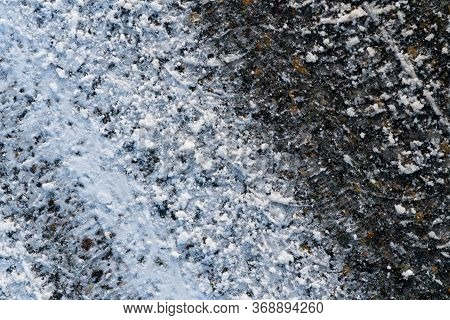 Track From Car Tire. Tread Pattern On The Snow. Asphalt Covered With A Thin Layer Of Snow. Pattern P