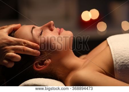 At Home Fingers Massage Head To Beautiful Girl. Girl Lying At Home Under Towel After Massage. Pleasa