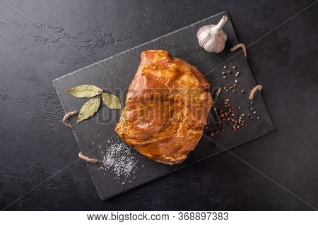 Ingredients For Cooking Homemade Baked Meat In Marinade On A Marble Board On A Dark Background. Top