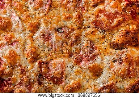 Pizza With Mozzarella And Salami Close-up. Food Background Concept