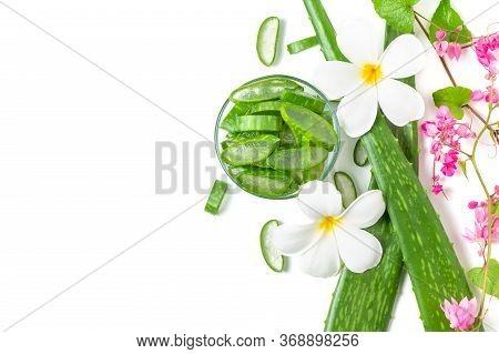 Slice Aloe Vera In Glass With Pink  Creeper And Plumeria Flower. Aloe Vera Are Digestive Help, Treat
