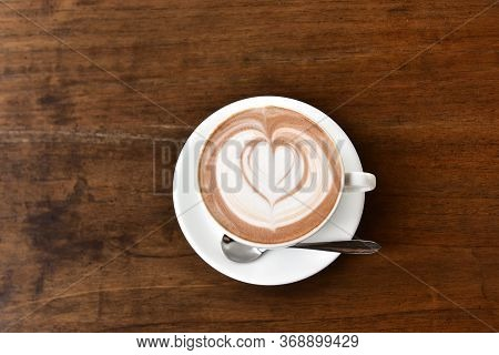 Coffee Cup With Latte Art On Wooden Table Menu In Coffee Break Time.latte Art Froth Design Pattern I