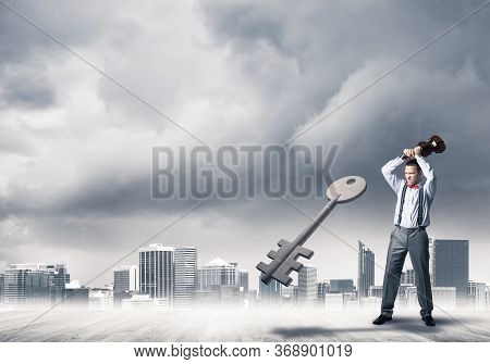Determined Businessman Against Modern Cityscape Breaking With Violin Stone Key Figure