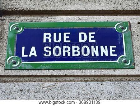 Rue De La Sorbonne Street Sign Close-up. Paris, France. Text: Street Of The Sorbonne.