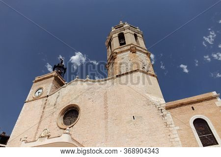 Low Angle View Of Church Of San Bartolome And Santa Tecla With Blue Sky At Background In Barcelona,