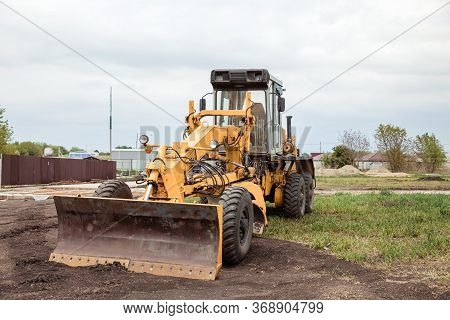 Yellow Bulldozer With Bucket. Wheel Loader. Yellow Front Loader. Heavy Equipment Machine. Tractor Fr