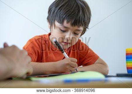 Cropped Shot Little Boy Using Pen Writing, Dad Helping His Son For His  Homework, Teacher Teaching L