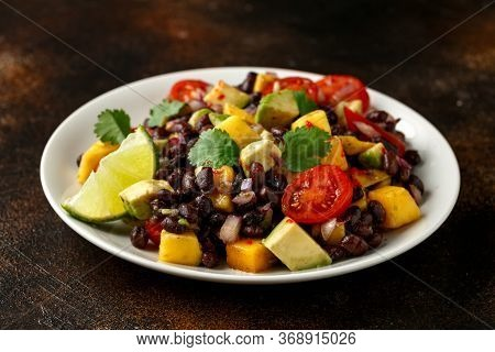 Avocado, Mango Salad With Black Bean On White Plate