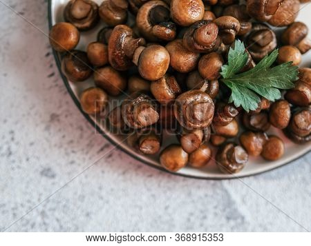 Ready-to-eat Fried Mini Champignons On Plate With Copy Space. Perfect Mini Mushrooms Heap On Plate O