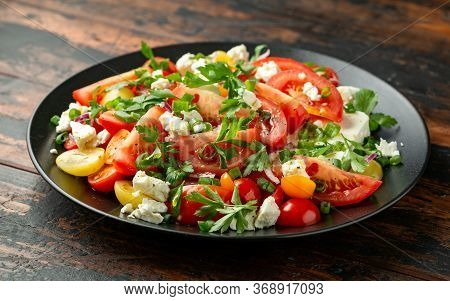 Tomato Salad With Feta Cheese, Spring Onion And Parsley. Healthy Summer Food