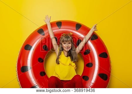 Child Sitting In An Inflatable Watermelon Shaped Swim Ring, Daydreaming About Beach Summer Vacations
