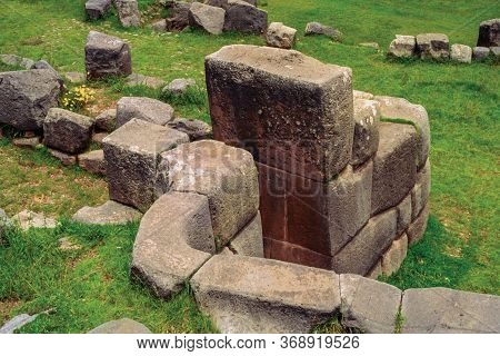 Finely Cut Stones Forming The Walls And Door At The Archaeological Site Of Sacsayhuaman In Cuzco. Th