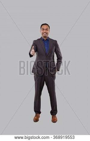 Indian Male Businessman Offering Hand To Shake. Greeting And Welcoming Gesture. Business Advertiseme