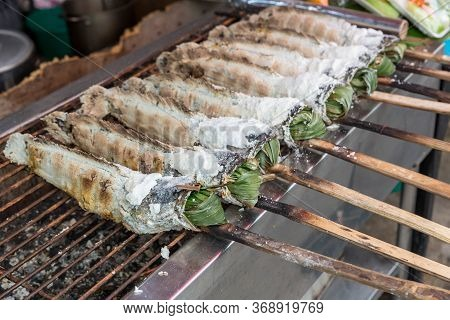 Striped Snakehead Fish Grilled With Salt. Pomegranate Fish With Salt And Then Burned For Sales In Th