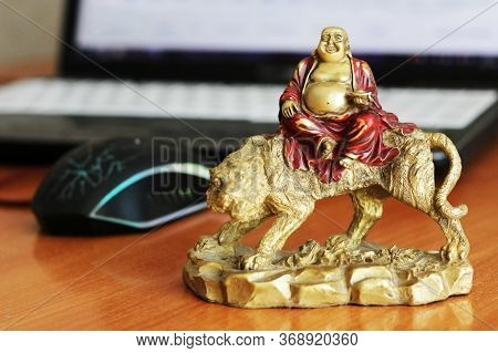 Laughing Buddha On The Desk In The Office, Feng Shui So Close