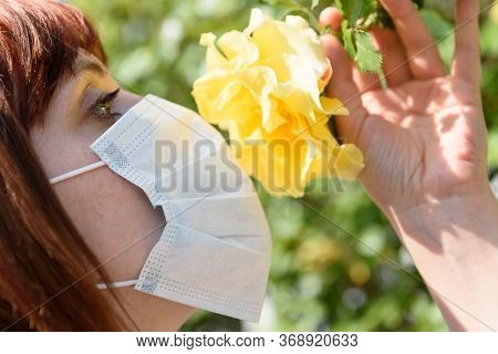 Girl With Red Hair And Sirurgical Mask, Smell Flower Yellow.
