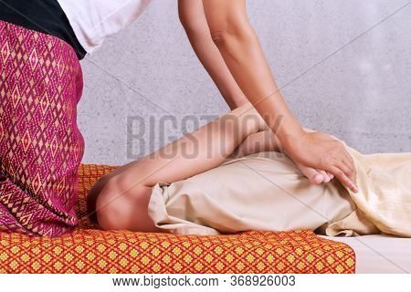 Close Up Hands Of Thai Masseuse Woman Getting Massage Leg For Customer. Leg Massage Treatment In The