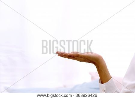 Hand Of Woman Holding Or Presenting Something On The Palm Of Her Hand On White Background With Copy