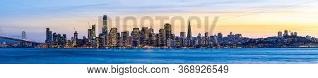 Panoramic cityscape of San Francisco skylines skyscrapers building with Bay Bridge at dusk in North California USA West Coast, San Francisco United States Landmark Travel Destination tourism concept.