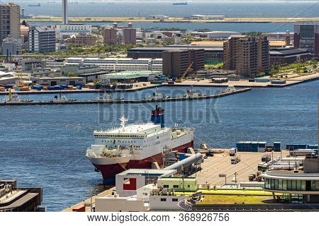 Aerial view of Tourist Cruise ship liner at Kobe port bay in downtown area of Kobe city Hyogo Japan