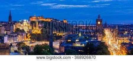 Night Panoramic of Edinburgh ancient old town Cityscape from Calton Hill sunset dusk, Edinburgh, Scotland UK, Web banner crop. Landmark cityscape and tourism concept.