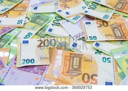 European Lies On The Table. Banknotes One Hundred, Two Hundred, Fifty, Five Hundred Euros Are Scatte