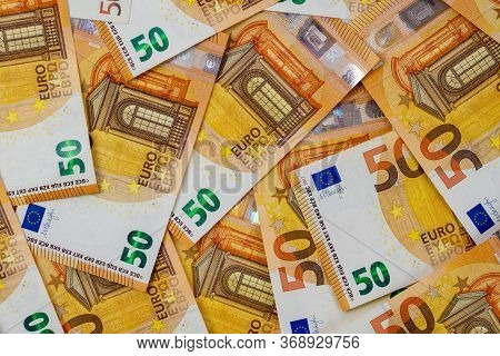Banknotes Of 50 Fifty Euros Are Scattered In A Chaotic Manner. European Blank For Design, Background