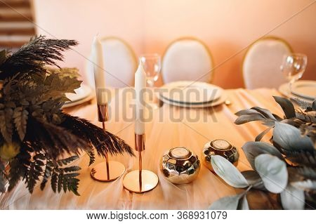 Presidium Table Setting With Empty Wine Glasses And Candles