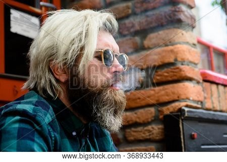 Cigarette Smoke. Close Up Portrait Of Smoking Man. Sensual Hipster With Cigarette. Bearded Man Smoke