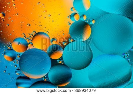Abstract Colorful Background With Oil On Water Surface. Oil Drops In Water Abstract Psychedelic. Spa