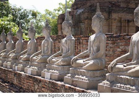 Old Buddha Statures In Side Wat Yai Chai Mongkol In Ayutthata, Thailand.