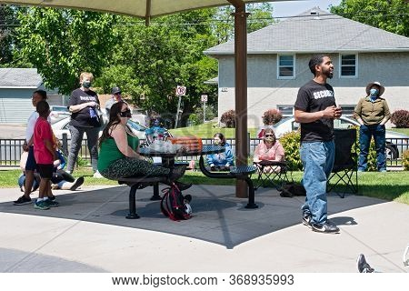 WEST ST. PAUL, MN/USA - May 30, 2020: West Saint Paul resident addresses racial issues at a community gathering in Harmon Park.