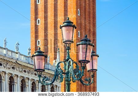 Richly decorated facade of the Palace of Dogey, campanila and street lantern. Doge's Palace is a  monument of Italian Gothic architecture. Magical journey to Venice. The concept of photo tourism