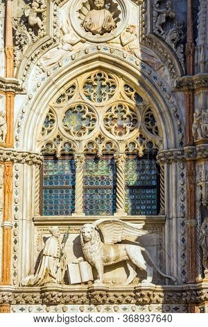 The magnificent decorated facade of the Palazzo Ducale. Doge's Palace is a great monument of Italian Gothic architecture. Magical journey to Venice. The concept of photo tourism