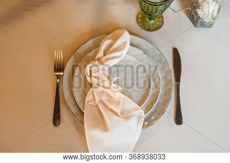 Top View Festive Table Setting With White Plate And Pink Napkin