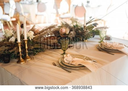 Presidium Table Setting With Green Wine Glasses And Candles