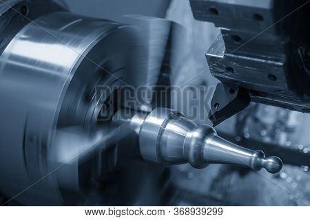 The  Cnc Lathe Machine Finish Cutting The Metal Shaft Parts. The Hi-technology Metal Working Process