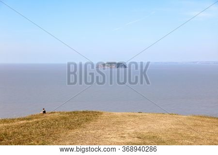 View Of The Island Steep Holm In The Bristol Channel From The Brean Down, Somerset. Uk