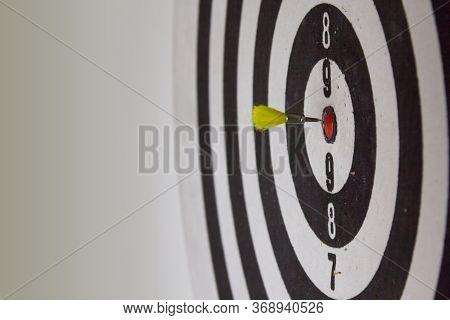 Bullseye! Dart From An Air Gun Is About To Hit A Dartboard. Concept For Reaching A Goal.
