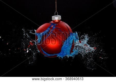 A Breaking Red Bauble. Concept For A Troublesome Christmas