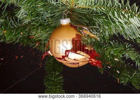 Bauble On A Christmas Tree Exploding. Red Liquid Splashing Around
