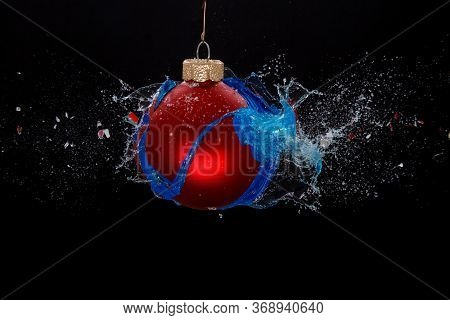 An Exploding Red Bauble, Concept Of A Turbulent Holiday