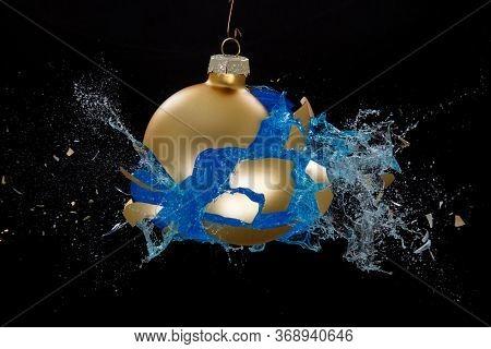 A Golden Bauble Breaking Liquid, Is Splashing Around