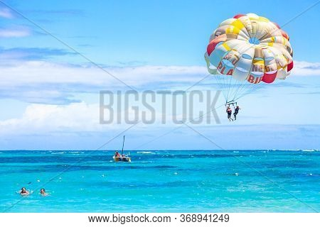 Bavaro Beach, Punta Cana, Dominican Republic - March, 2020: Tourists Parasailing On Bavaro Beach In