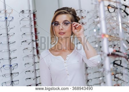 Woman In Spectacles. Eyesight Correction. Girl Wearing Glasses. Portrait Of A Woman In Correcting Gl